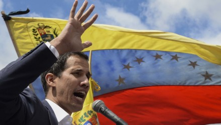 "Venezuela's National Assembly head Juan Guaido speaks to the crowd during a mass opposition rally against leader Nicolas Maduro in which he declared himself the country's ""acting president"", on the anniversary of a 1958 uprising that overthrew military dictatorship, in Caracas on January 23, 2019. - ""I swear to formally assume the national executive powers as acting president of Venezuela to end the usurpation, (install) a transitional government and hold free elections,"" said Guaido as thousands of supporters cheered. Moments earlier, the loyalist-dominated Supreme Court ordered a criminal investigation of the opposition-controlled legislature. (Photo by Federico PARRA / AFP)"
