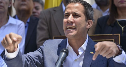 Venezuelan opposition leader and self-proclaimed acting president Juan Guaido speaks during a press conference at the Venezuelan National Assembly in Caracas on March 10, 2019. - Sunday is the third day Venezuelans remain without communications, electricity or water, in an unprecedented power outage that already left 15 patients dead and threatens with extending indefinitely, increasing distress for the severe political and economic crisis hitting the oil-rich South American nation. (Photo by Matias DELACROIX / AFP)