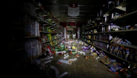 Damage is seen in a supermarket after it was looted during an ongoing blackout in Caracas, Venezuela March 10, 2019. REUTERS/Carlos Garcia Rawlins