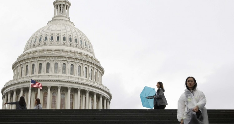 WASHINGTON, DC - SEPTEMBER 30: Visitors walk across the east front of the U.S. Capitol during a rain storm, on September 30, 2019, on Capitol Hill in Washington, D.C. Select Congressional committees will return to the Capitol to continue impeachment proceedings throughout the week as Congress remains on recess.   Tom Brenner/Getty Images/AFP