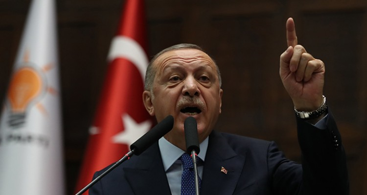 Turkey's President Recep Tayyip Erdogan and leader of the ruling Justice and Development (AK) Party addresses party members during his party's parliamentary group meeting at the Turkish National Assembly in Ankara, on October 16, 2019. (Photo by Adem ALTAN / AFP)