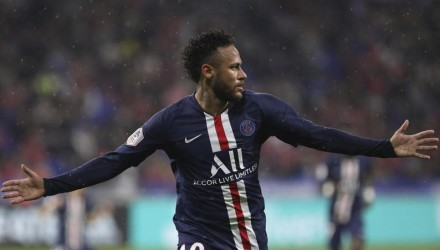 PSG's Neymar celebrates after scoring the opening goal of the game during the French League 1 soccer match between Lyon and Paris SG, at the Stade de Lyon in Decines, outside Lyon, France, Sunday, Sept. 22, 2019. (AP Photo/Laurent Cipriani)